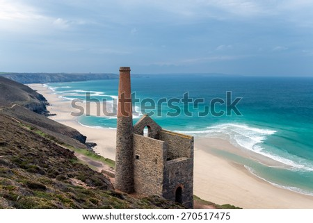 The ruins of an old Cornish engine house on the South West Coast Path as it passes through St Agnes on the north coast of Cornwall - stock photo