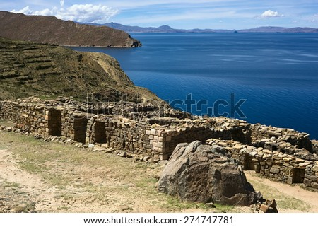The ruins of Chinkana of Tiwanaku-Inca origin on Isla del Sol (Island of the Sun), a popular tourist destination in Lake Titicaca, Bolivia - stock photo