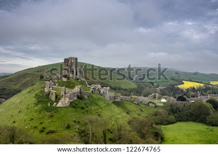 The ruins of Corfe Castle in Dorset on a blustery spring day - stock photo