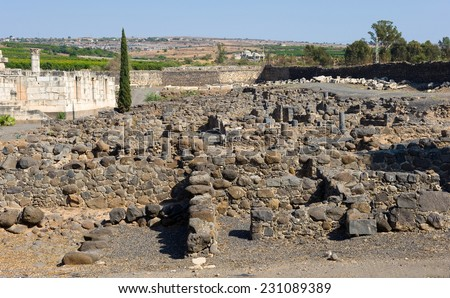 The ruins of houses in the small town Capernaum on the coast of the lake of Galilee.  Left the Synagogue. According to the bible this is the place where Jesus lived and taught - stock photo