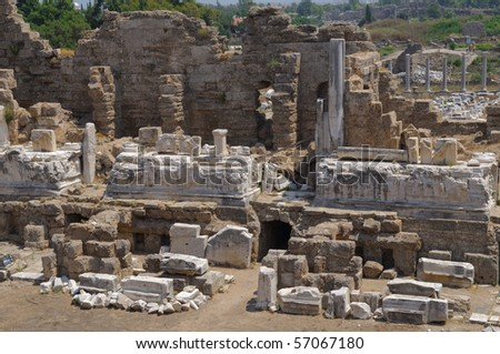 The ruins of the ancient amphitheater. Turkey, Side. Amid the ruins - ancient columns. - stock photo