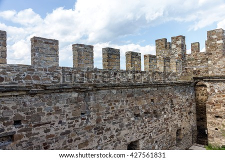 The ruins of the ancient Turkish fortress in Crimea, Sudak. The ruins of the ancient city. The fortress on the cliffs. Ruined wall of ancient medieval fortress. Remains of an ancient fortress - stock photo