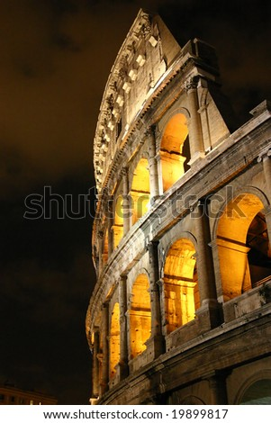 The ruins of the Colosseum in the heart of the Rome at night - stock photo