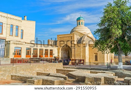 The ruins of the old bazaar with the Toqi Sarrafon Trading Dome on the background, Bukhara, Uzbekistan. - stock photo