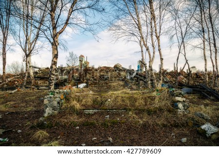 The ruins of the old building.The remains of a building overgrown with grass and trees - stock photo
