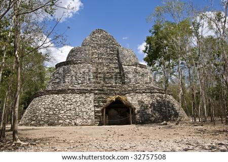 The ruins of The Oval Temple, an ancient Mayan pyramid at Coba, Mexico. - stock photo