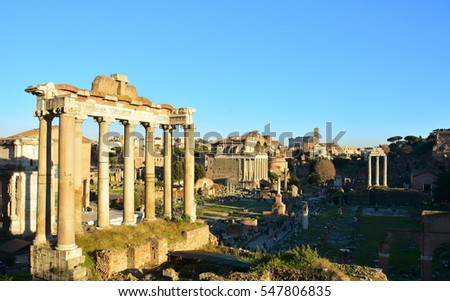 The ruins of the Roman Forum in Rome at sunset.