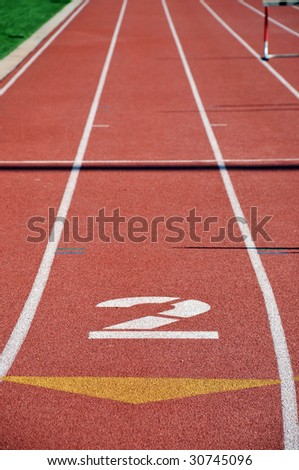 the running lanes of a track on a sunny day - stock photo