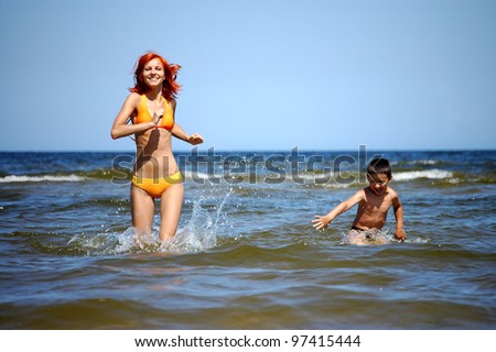 The running mother  and son on the sea
