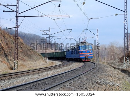 The running train in the middle of Siberian forest