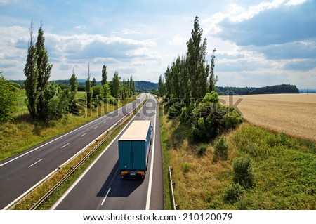 The rural landscape with a highway leading poplar alley, truck driving down the highway, view from above - stock photo