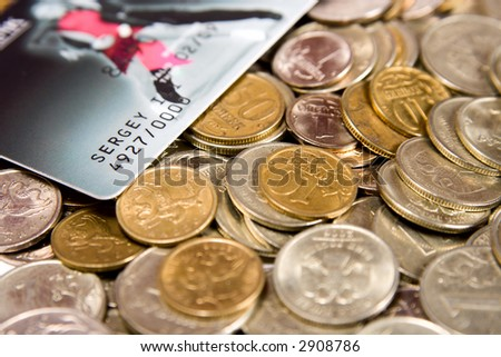 The Russian metal coins with a credit card. - stock photo