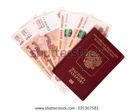 The Russian passport in a red cover lies on a pile of notes (rubles)