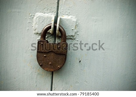 The rusty lock on the gray gate - stock photo