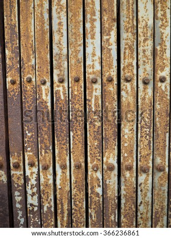 The rusty steel door background with close up.