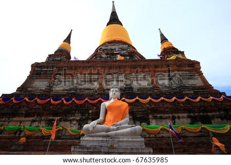 The sacred white Buddha image in front of the ancient pagodas in Ayuthaya, Thailand - stock photo