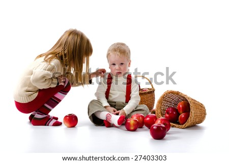 The sad boy and the girl near the scattered apples. On a white background. - stock photo