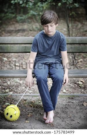 The sad boy with a balloon - stock photo