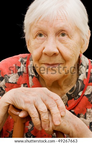 The sad old woman on the black - stock photo