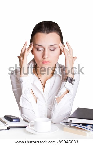 The sad woman is sitting on her workplaces. Clipping path