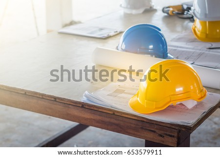 Safety helmet blueprint on table construction stock photo edit now the safety helmet and the blueprint on table at construction site malvernweather Images