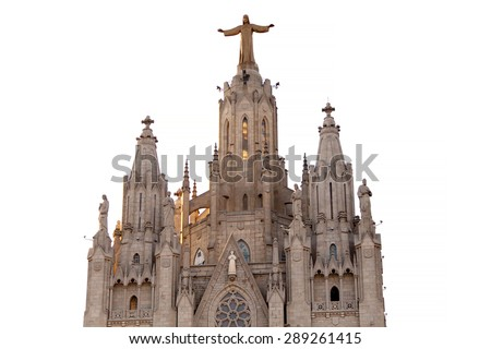 The Sagrat Cor church atop the mountain. Barcelona, Spain. Isolated on white background Statue. - stock photo