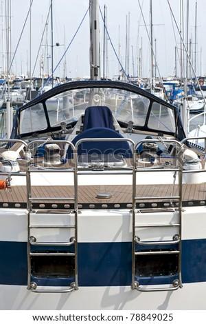 The sail boat moored in marina. - stock photo