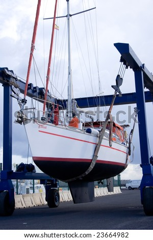 The sailboat lift up by a travel lift. - stock photo