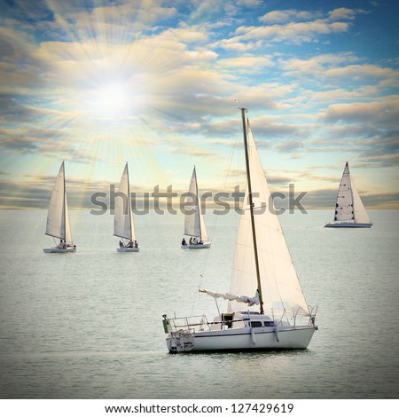 The Sailboats on a sea against a dramatic sky. Retro style picture. - stock photo