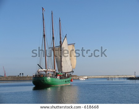The sailing ship Pippilotta of Hamburg on its way out of the harbour of Nyborg, Denmark - stock photo