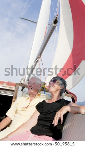 The sailor couple enjoy sailing with the cruising chute in the summer. - stock photo