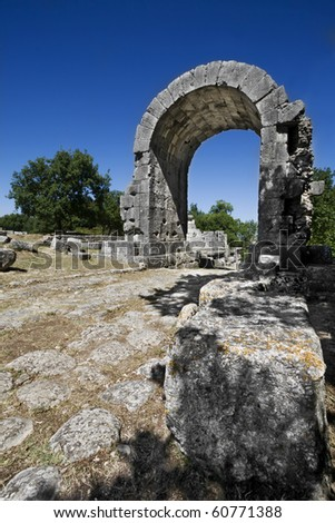 The Saint Damian's arch at Carsulae (Terni - IT). City of Carsulae is an important archeological site not yet been fully brought to light. - stock photo