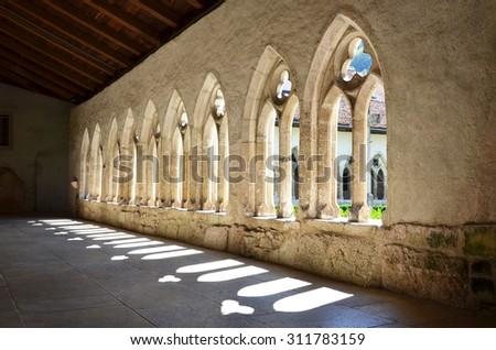 The Saint Ursanne collegiate church and its cloister. Canton Jura, Switzerland - stock photo