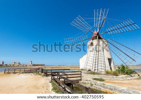 The salt flats with windmills of Trapani, Sicily (Italy) - stock photo