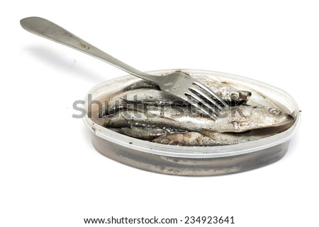 the salted sprat in a plastic box, it is isolated on the white