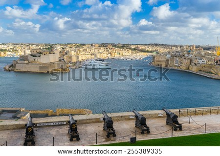 The Saluting Battery of Valletta looking across the Grand Harbour - stock photo