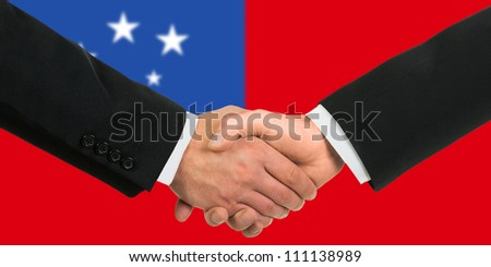 The Samoa flag and business handshake