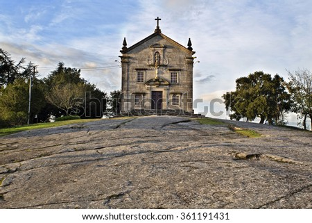 """The Sanctuary of Our Lady of Pilar at sunset in Povoa de Lanhoso, Portugal. """"Give your Alms"""" written on the sign. - stock photo"""