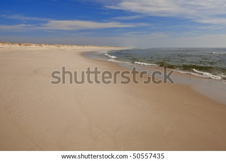 The sand and surf at NJ's Island Beach State Park. - stock photo