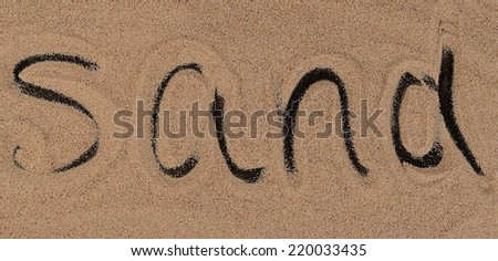 The sand on the black background close-up - stock photo
