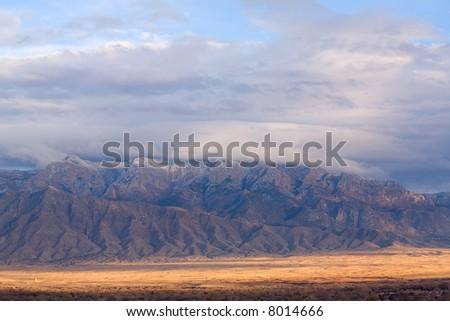 The Sandia's east of Albuquerque, NM. - stock photo