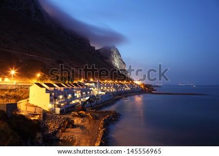 The Sandy Bay in Gibraltar at dusk - stock photo