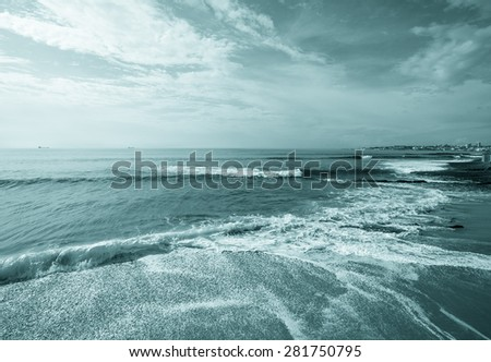 The sandy shores of the Atlantic Ocean. Portugal. Toned. - stock photo