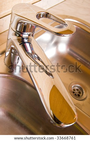 The sanitary faucet on kitchen - stock photo