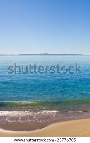The Santa Barbara channel along Butterfly Beach with Santa Cruz Island in the background. - stock photo