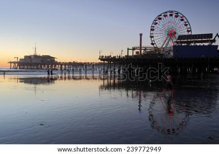 The Santa Monica beach and pier at dusk.  - stock photo
