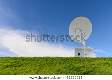 The satellite station and meadow with blue sky background - stock photo