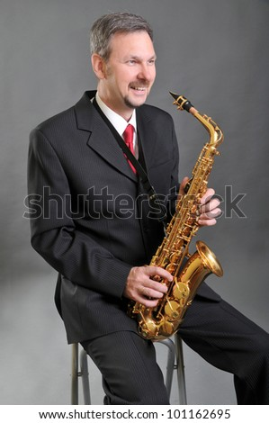The saxophonist in a black jacket - stock photo