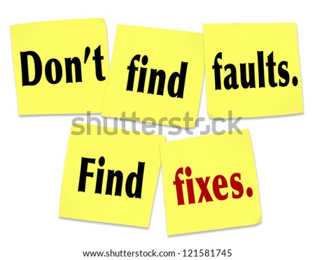 The saying Don't find faults, find fixes with words on yellow sticky notes offering advice on how to be useful and provide help and assistance to someone with flaws, trouble or a problem - stock photo