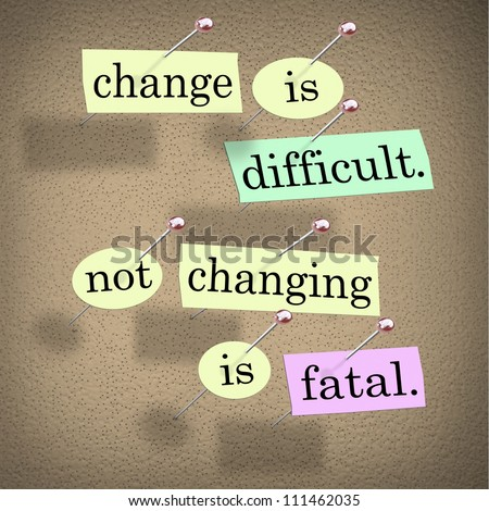 The saying or motto Change is Difficult, Not Changing is Fatal with words stuck onto a bulletin board to remind you of this important message on the importance of adapting to changes - stock photo